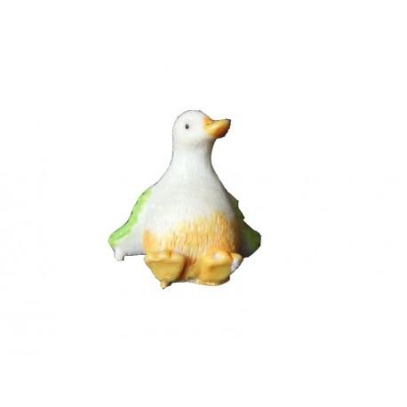petit-canard-assis-autocollant-jaune-avec-ailes-vertes