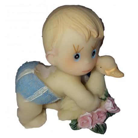 figurine miniature1 bébé fille couché sur le ventre sur un coussin rose