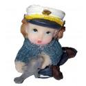 Figurine miniature 1 fillette habillée en marin jouant avec un petit dauphin