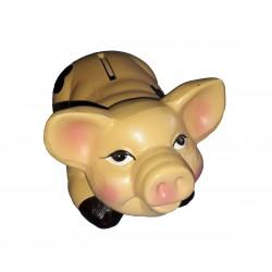 Tirelire en forme de cochon couché sur le dos avec un gros sourir dans une caisse en bois